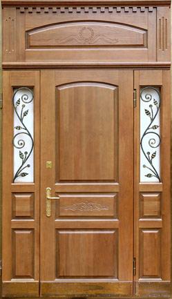 Элитные металлические входные двери с отделкой  массивом дуба